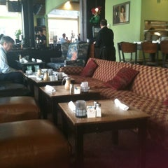 Photo taken at Busboys and Poets by Emily M. on 11/21/2011