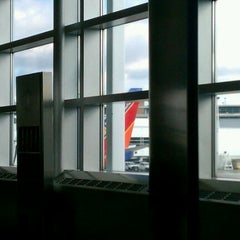 Photo taken at Concourse B by Joe N. on 1/1/2012