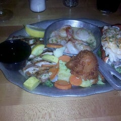 Photo taken at Norwood's Restaurant & Wine Shop by Robert R. on 7/13/2012