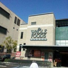 Photo taken at Whole Foods Market by Julez J. on 12/8/2011