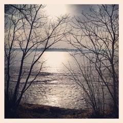 Photo taken at Lake Calhoun by Jesse V. on 3/13/2012