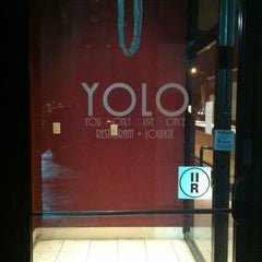 Photo taken at YOLO Restaurant + Lounge by Mel B. on 11/30/2011