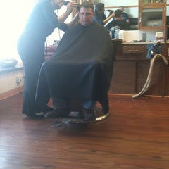 Photo taken at Jerry's Barber Shop by Fred G. on 3/17/2011