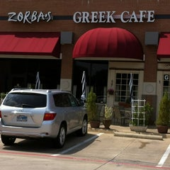 Photo taken at Zorba's Greek Cafe by Kate C. on 3/30/2012