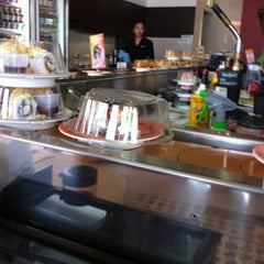 Photo taken at Sushi Train by Spatial Media on 4/22/2012