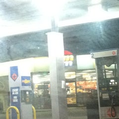 Photo taken at AMPM by Ginelle C. on 3/19/2011
