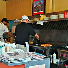 Photo taken at The Uptowner Cafe on Grand by Brian G. on 5/27/2012