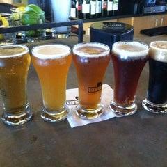 Photo taken at Destihl Restaurant & Brew Works by Ryan M. on 4/12/2011