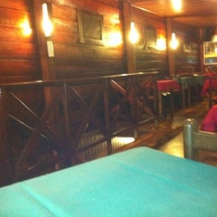 Photo taken at Famiglia Sant'ana by BerG A. on 2/13/2012