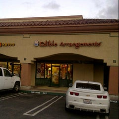 Photo taken at Edible Arrangements by Lalo R. on 2/14/2012