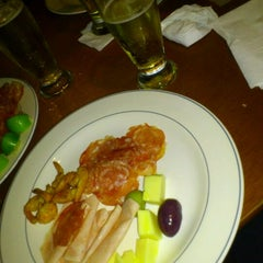 Photo taken at Bovinu's Beer & Grill by ANDREA B. on 6/6/2012
