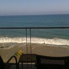 Photo taken at Malibu Beach Inn by Kristi B. on 5/21/2012