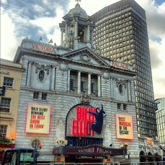 Photo taken at Victoria Palace Theatre by Douglas D. on 6/19/2012