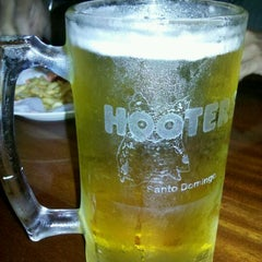 Photo taken at Hooters by Erickson O. on 5/10/2012
