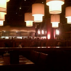 Photo taken at Flame Rotisserie Grill & Bar by Steve T. on 2/2/2011