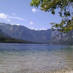 Photo taken at Bohinjsko jezero (Bohinj Lake) by David K. on 9/3/2011