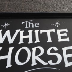 Photo taken at White Horse by Charles P. on 3/5/2012