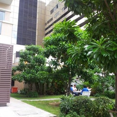 Photo taken at Thai CC residence garden by Wisit B. on 7/3/2012