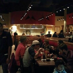 Photo taken at Genghis Grill by Mona C. on 11/27/2011