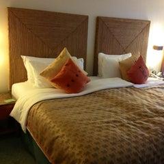 Photo taken at Shangri-La's Mactan Resort and Spa by Noel L. on 5/27/2012