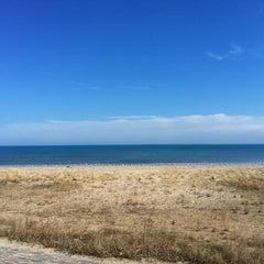 Photo taken at 63rd Street Beach by Christina S. on 3/18/2012
