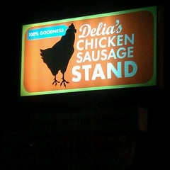 Photo taken at Delia's Chicken Sausage Stand by Nikki on 6/21/2012