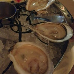 Photo taken at Henlopen City Oyster House by Leslie S. on 3/1/2012