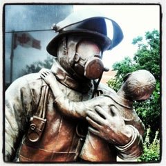 Photo taken at Ontario Fire Fighters Memorial by Alex G. on 7/17/2012