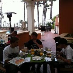 Photo taken at Shades Restaurant & Bar by Arthur M. on 8/5/2011