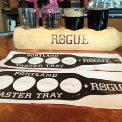 Photo taken at Rogue Ales Public House by Alister R. on 4/15/2012