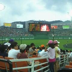 Photo taken at 사직야구장 (Sajik Baseball Stadium) by Alex Y. on 8/4/2011