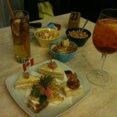 Photo taken at Kontatto Cafe by Ilaria G. on 3/25/2012