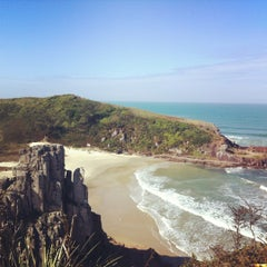 Photo taken at Praia da Guarita by Carlos G. on 5/6/2012