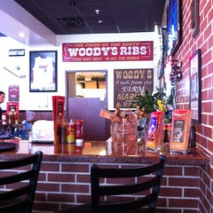 Photo taken at Woodys Bar-B-que by Andrea F. on 7/28/2012