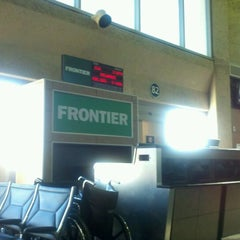 Photo taken at Frontier Airlines by Brad P. on 12/31/2011