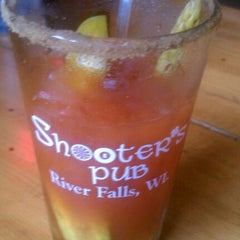 Photo taken at Shooter's Pub by Linzi H. on 1/1/2012