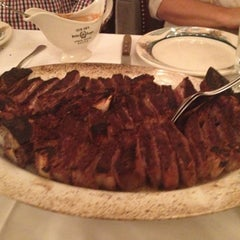 Photo taken at Peter Luger Steak House by Ovi V. on 8/18/2012