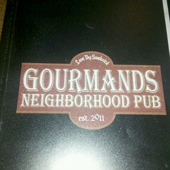 Photo taken at Gourmands Neighborhood Pub by Theda S. on 12/23/2011