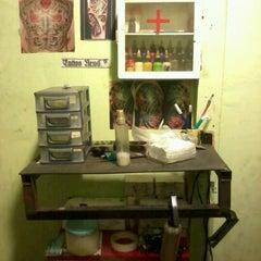 Photo taken at RAVENTH Tattoo Studio by Fisyahri R. on 6/21/2012