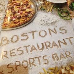Photo taken at Boston's Restaurant & Sports Bar by Kelly G. on 6/30/2012
