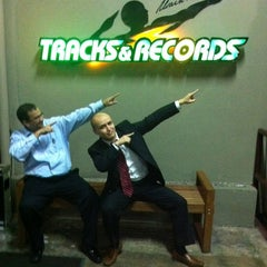 Photo taken at Usain Bolt's Tracks & Records by Ivan G. on 2/29/2012