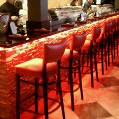 Photo taken at Tasu Asian Bistro Sushi & Bar by Chris M. on 10/11/2011