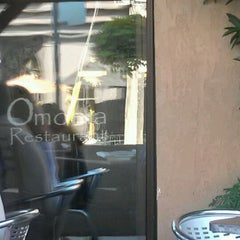 Photo taken at Omonia Restaurant by Alexandre G. on 7/29/2012