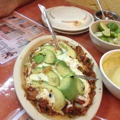 Photo taken at Tacos El Sabores by Erick V. on 6/30/2012