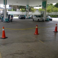 Photo taken at Petronas by Muhammad N. on 3/13/2012