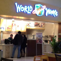 Photo taken at World Wrapps by Jennifer M. on 3/28/2012