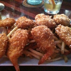 Photo taken at Wowies Sports Grill by Matthew on 7/28/2012