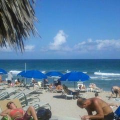 Photo taken at Bamboo Beach Tiki Bar & Cafe by Franklin C. on 2/28/2012