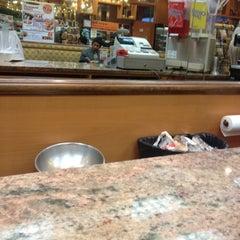 Photo taken at Café Bonjour Deli & Pizza by Terri N. on 2/9/2012