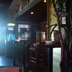 Photo taken at Island Dogs Bar by Daya on 3/26/2012